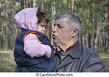 Grandfather soothes little distressed granddaughter - Spring...