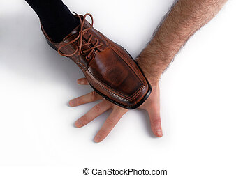 Shoe crushing a hand over white background. Upper view