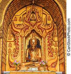 Golden Buddha statue in the church Inle lake, Shan state of...