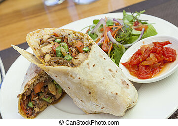 Chicken roti - Chicken curry roti wrap with salad and relish