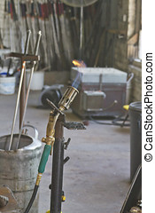 Blowtorch - A lit blowtorch in a glass blowing studio
