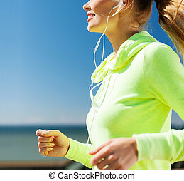 woman running outdoors - sport and healthy lifestyle concept...