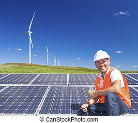 Sustainable clean energy technician with solar panels and...