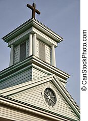 Church steeple - A church steeple with a cross at it's very...