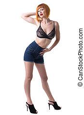 Sexy redhead woman posing in studio
