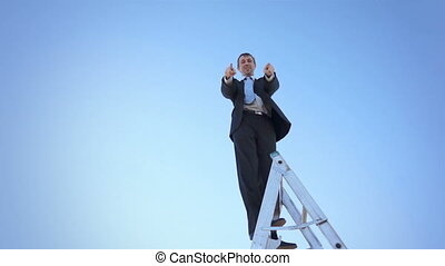 Businessman on Ladder Thumbs Up