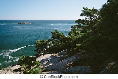 Cliffs and view of the Atlantic Ocean in Acadia National...