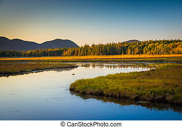Evening light on a stream and mountains near Tremont, in...