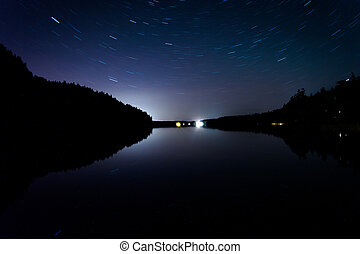 Star trails over Echo Lake, in Acadia National Park, Maine.