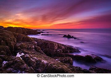 Sunrise over rocky coast and the Atlantic Ocean at Acadia...