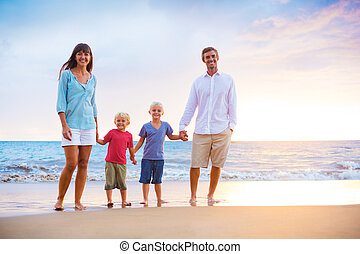 Happy Family with Two Young Kids