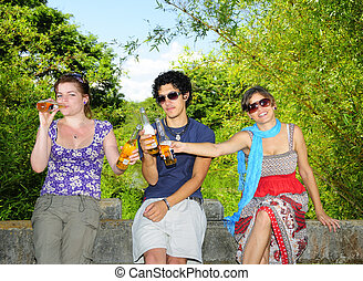 Friends drinking beer - Portrait of three young friends...