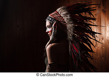 Indian woman with traditional make up and headdress looking...