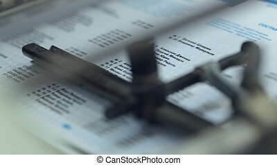 Close up of sheet printing technology in printing office