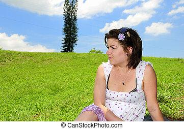 woman on green summer grass
