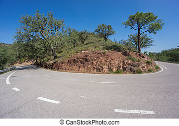 Worms eye view of mountain hairpin bend curved road -...