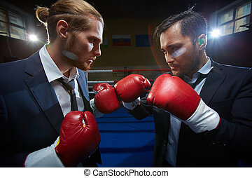 Business boxers - Angry men in suits and boxing gloves...