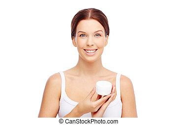 Presenting cream - Young woman holding a box with facial or...
