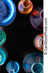 Fluid substances - Circle of flasks with multi-color...