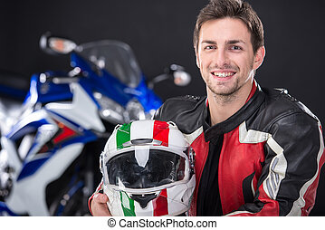 Motorcycle - Portrait of young smiling man with helmet. The...