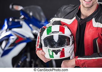 Motorcycle - Portrait of smiling man with helmet The...