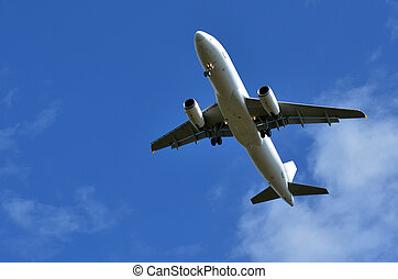 Commercial airplane flying in blue sky. concept photo travel...