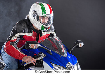 Motorcycle - Motorcyclist in red equipment and helmet on...