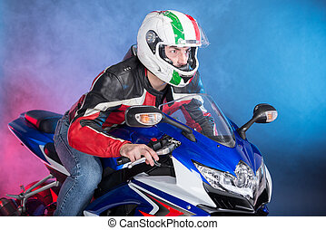 Motorcycle - Motorcyclist in equipment and helmet on foggy...