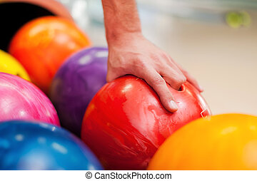 I choose this one Close-up of a hand holding bowling ball