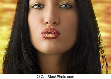 giving a kiss - beautiful young woman with dark hair and...