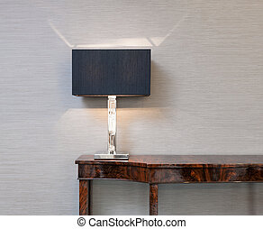 Sideboard with table lamp - Sideboard in front of a grey...