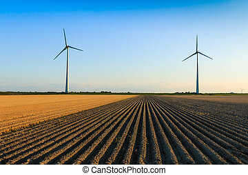 Windmills at farmer fields - Windmills at sunset at a farmer...