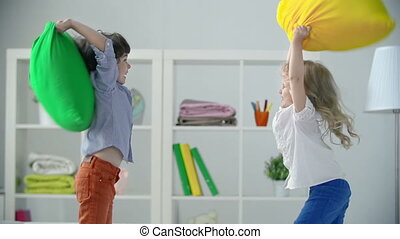 Pillow Fight - Two adorable kids misbehaving pillow fighting