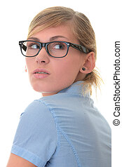 Portrait of a thoughtful young woman in blue shirt and...