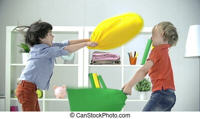 Home Party - Two boys having pillow fight at home