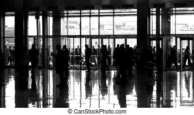 silhouette people in enter hall - Silhouette of people in...
