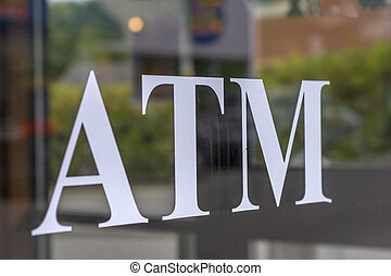 ATM - The word ATM on window of bank