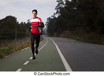 Runner man portrait with flash light outdoors