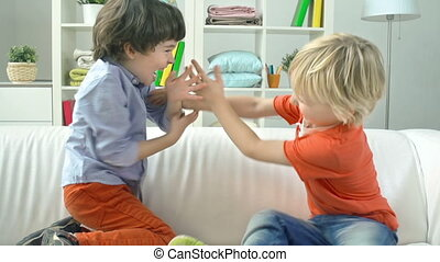 Rough Children - Close up of two little boys fighting in...