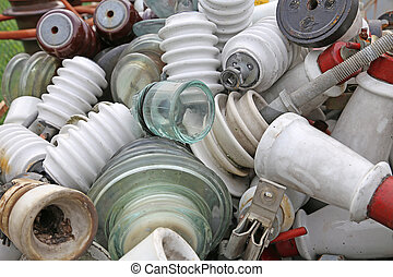 old ceramic insulators in an old dump obsolete material -...
