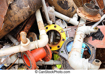 iron pipes of a landfill of ferrous material - rusted iron...