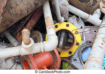 rusted iron pipes of a landfill of ferrous material