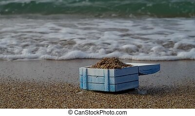 Empty treasure chest on a deserted island.