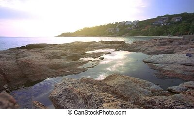 Time lapse of Sunset over a rocky coast on Koh Samui...