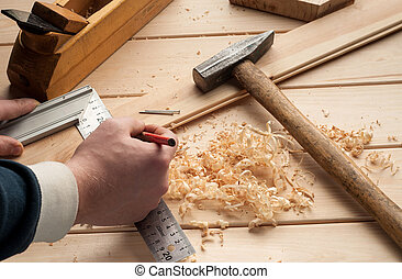 carpenter tools,hammer,meter, nails,shavings, and plane over wood table