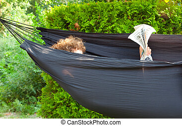 reading the newpaper in a hammock