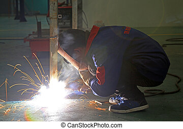 manufacturing welders - welders in a manufacturing factory,...