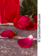 valentine roses - Gift with roses on wooden background