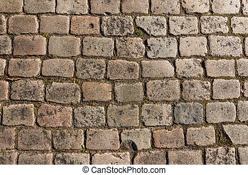 Old cobbled street background - Old cobbled street in The...