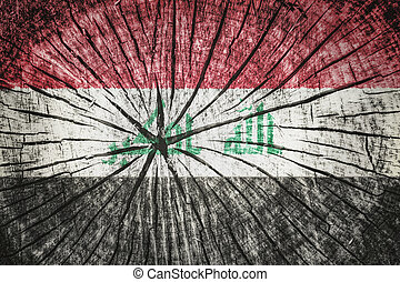 flag of Iraq on cracked wooden texture